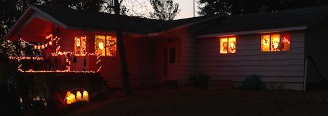 our house with lights at night